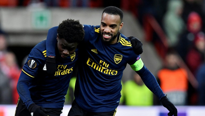 Double act: Bukayo Saka celebrates with Alexandre Lacazette